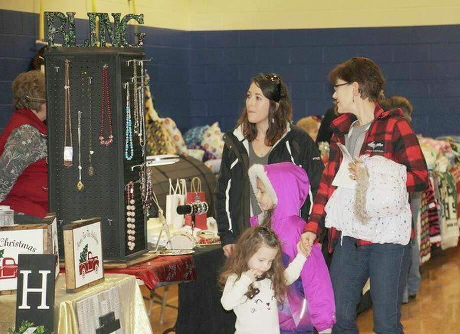 Hundreds of festive shoppers stopped by Bad Axe Middle Schoollast year for the annual Mistletoe Market, hosted by the Huron Daily Tribune. This year's event is Saturday. (Tribune File Photo)