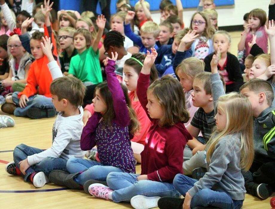 Kindergarten and first-grade students at Riverview Elementary School learned about fire safety Monday from Big Rapids Department of Public Safety firefighters. Students learned tips including getting outside as quickly as possible and never hiding from firefighters. (Pioneer photo/Taylor Fussman)