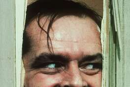 """Actor Jack Nicholson, portraying """"Jack Torrance"""" in the movie """"The Shining"""" directed by Stanley Kubrick, peers through a hole in a door, in this handout picture. Kubrick died Sunday, March 7, 1999 at his home in England, his family said. He was 70. (AP Photo/Warner Bros. Inc.)"""