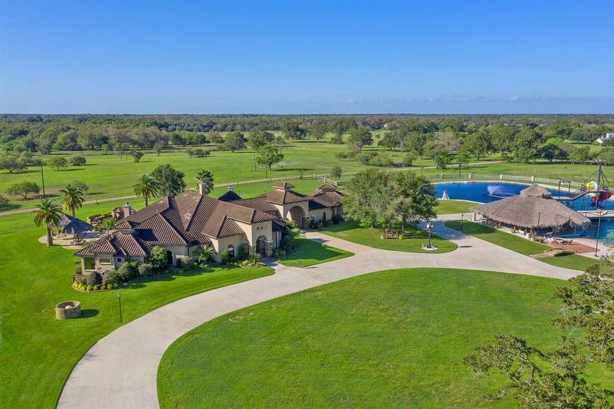 Located just about an hour away from downtown Houston, this one of a kind Richmond estate comes with its own private lake water park. Nestled over 20 acres, the stunning home boasts four bedrooms, four full and two half bathrooms, wine cellar with cigar humidor, theater room and a four-car garage that currently serves as a