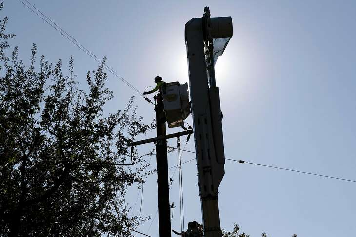 PG&E contractors work on power lines on Chalk Hill Road in Healdsburg, California, on Monday, November 4th, 2019.