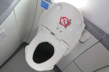 Incredible Airplane Toilet Seats Up Or Down Sfgate Caraccident5 Cool Chair Designs And Ideas Caraccident5Info