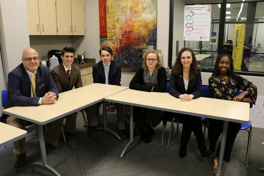 Members of the debate team are, Mitchell Sharum, junior, second from left; Ethan Parks, sophomore; Sydney Laing, sophomore; Danielle Bryden, junior; and Deborah Bajomo, junior. Not pictured: Jude Fanous, freshman. The advisor is John Klassen, far left. Photo: Courtesy Photo