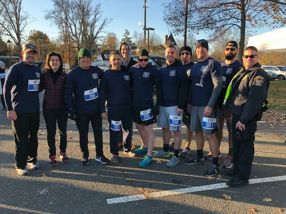 Women's Center Board Chair Glori Norwitt with members of the Cops & Robbers 5K Photo: Contributed Photo