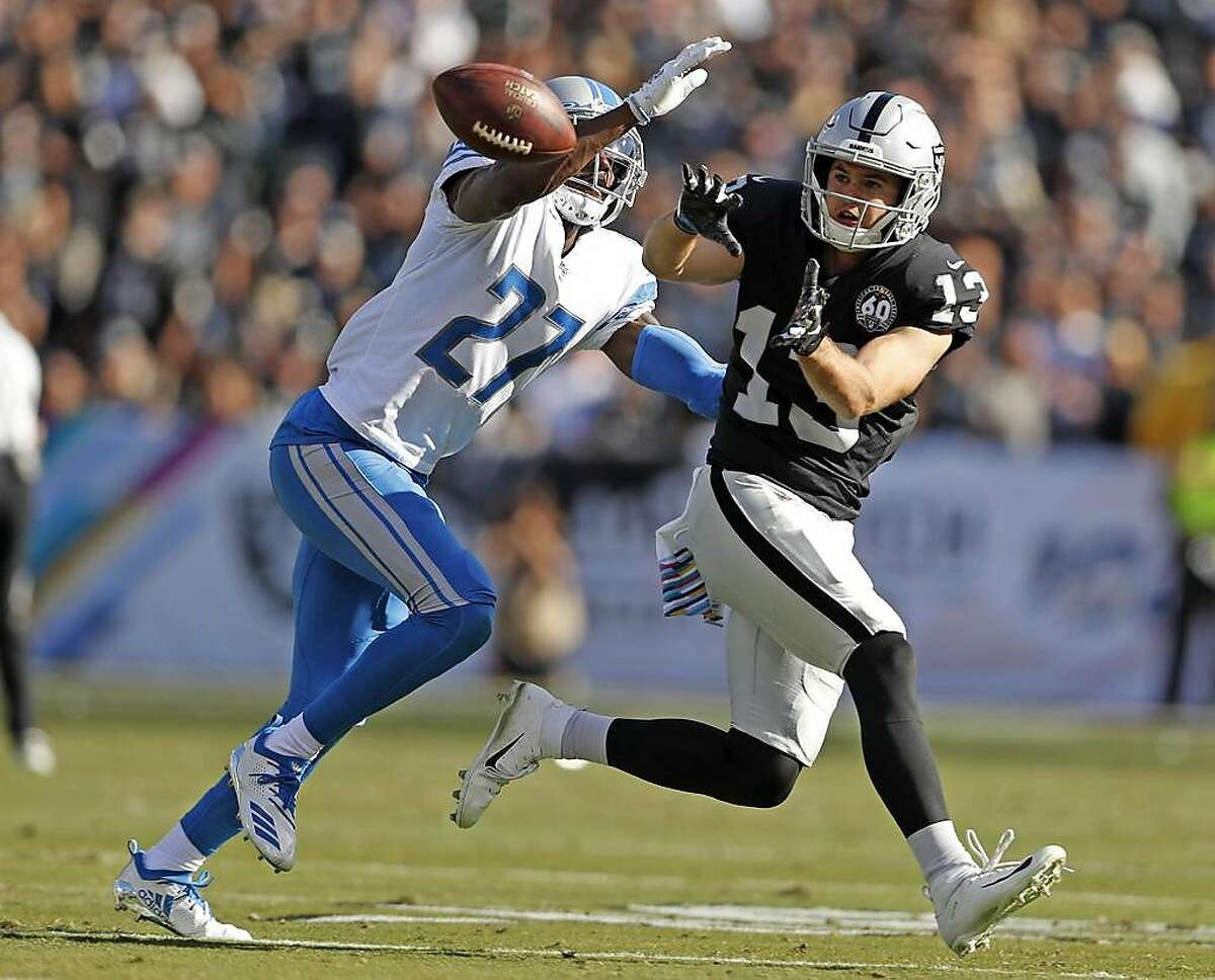 Oakland Raiders' Hunter Renfrow catches a pass in front of Detroit Lions' Justin Coleman in 2nd quarter during NFL game at Oakland Coliseum in Oakland, Calif., on Sunday, November 3, 2019.
