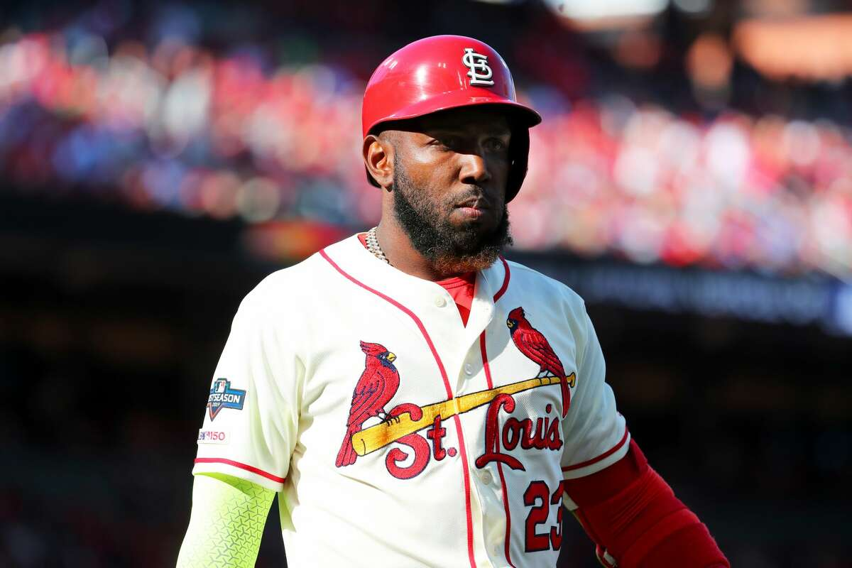 FILE - Marcell Ozuna #23 of the St. Louis Cardinals reacts after striking out swinging during the first inning of Game 2 of the NLCS between the Washington Nationals and the St. Louis Cardinals at Busch Stadium on Saturday, October 12, 2019 in St. Louis, Missouri.