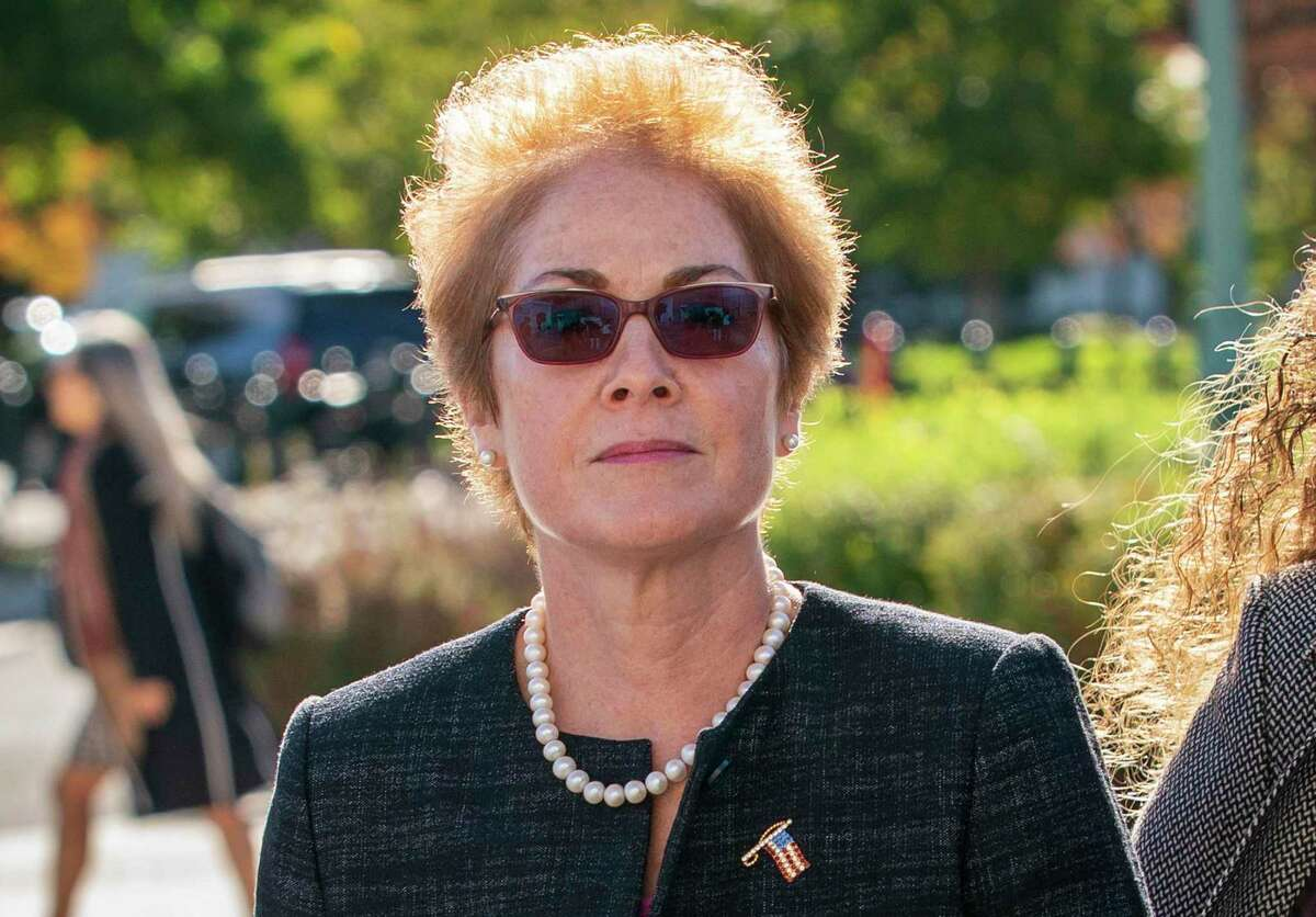 """In this Oct. 11, 2019, file photo, former U.S. ambassador to Ukraine Marie Yovanovitch, arrives on Capitol Hill in Washington. The House impeachment panels are starting to release transcripts from their investigation. And in one of them, Yovanovitch says that Ukrainian officials warned her in advance that Rudy Giuliani and his allies were planning to """"do things, including to me."""" ("""