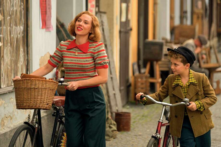 """This image released by Fox Searchlight Pictures shows Scarlett Johansson, left, and Roman Griffin Davis in a scene from the WWII satirical film """"Jojo Rabbit."""" (Larry Horricks/Fox Searchlight Pictures via AP) Photo: Larry Horricks / Fox Searchlight Pictures"""