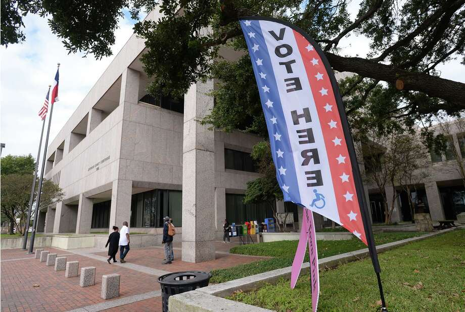 Guests of the Jefferson County Courthouse walk past a vote here sign on Monday. Voting for the municipal races are today. Photo taken Monday, 11/4/19 Photo: Guiseppe Barranco/The Enterprise, Photo Editor / Guiseppe Barranco ©