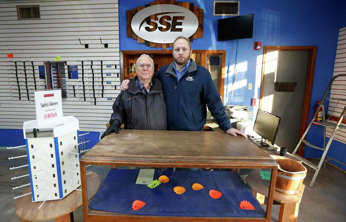 Kevin Doffing (right) and his 79-year-old father, Larry Doffing, ran Sam's Safety Equipment, a family-owned business, for nearly 50 years, but closed the business in June due to an increasingly competitive market as well as difficulties in recovering after the business was flooded in multiple storms.