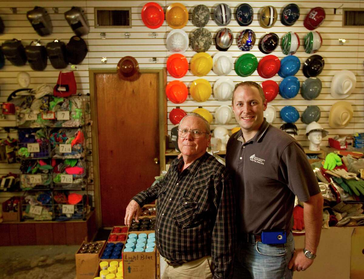 Kevin Doffing, right, owner of Sam's Safety Equipment, is shown with his father Larry Doffing, seven years earlier on Monday, Oct. 29, 2012, in Houston.