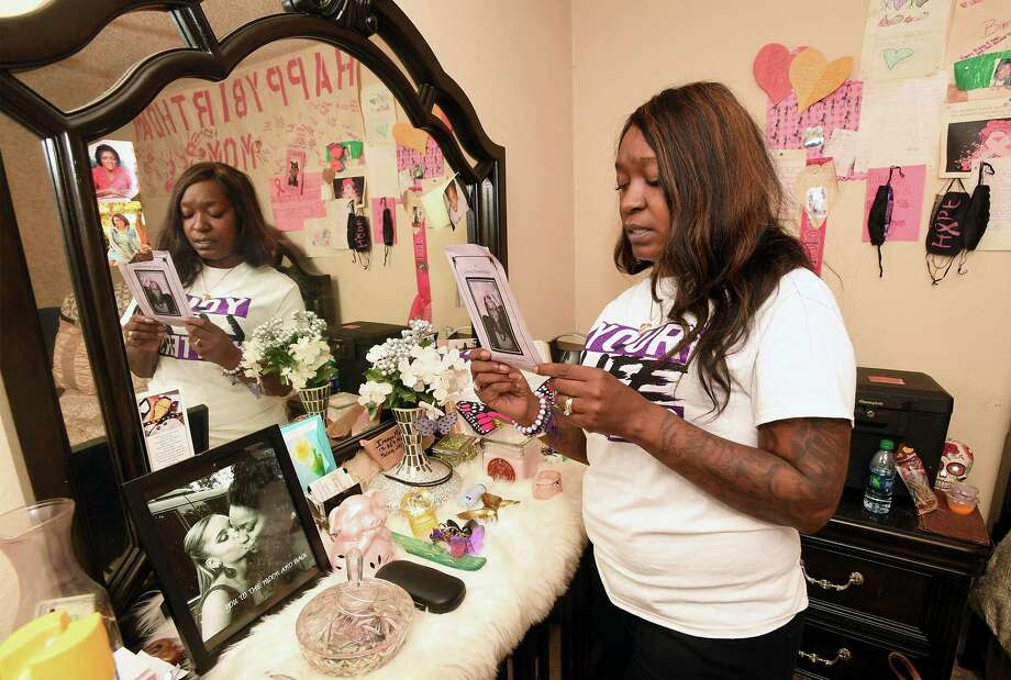 Kandice Kennedy looks Wednesday the program from her daughter Zaria Kennedy's funeral. Kandice said her daughter was bullied at school for several years before committing suicide in 2018. Photo taken Thursday, 10/24/19 Photo: Guiseppe Barranco/The Enterprise, Photo Editor / Guiseppe Barranco ©
