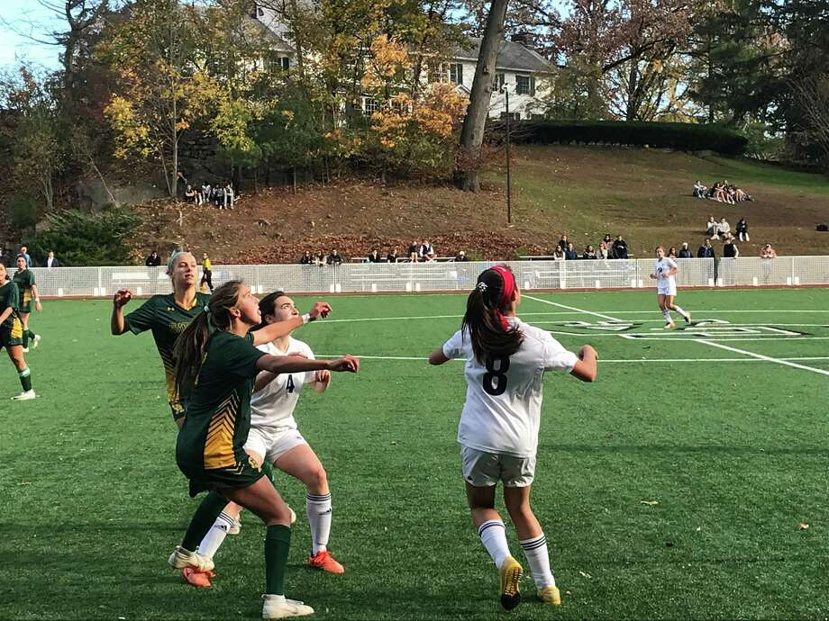 Kit Harned of Greenwich Academy, left, waits for the ball to approach her, as do Lauren Baine of Rye Country Day School, middle and Marlin Yearly of RCDS, during the FAA soccer quarterfinals. In the back is Paige Lipman of Greenwich Academy. Host Greenwich Academy won the game played on Monday, November 4, 2019. Photo: David Fierro /Hearst Connecticut Media