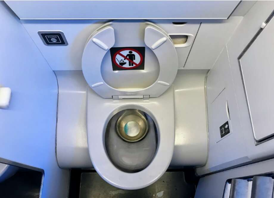 Airplane toilet seats: Leave them up or down? Photo: Chris McGinnis