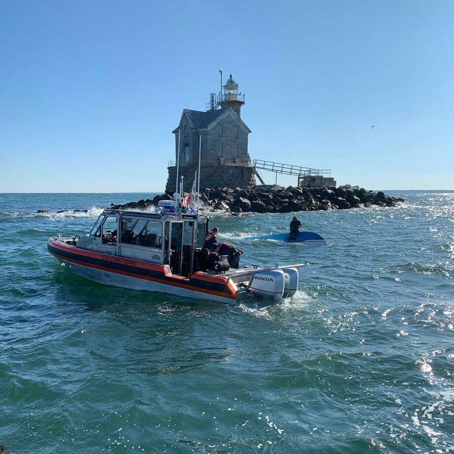 A picture posted to Twitter by the Coast Guard of a capsized boat near the Middle Ground lighthouse. Photo: Contributed