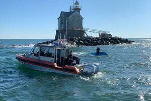 A picture posted to Twitter by the Coast Guard of a capsized boat near the Middle Ground lighthouse.