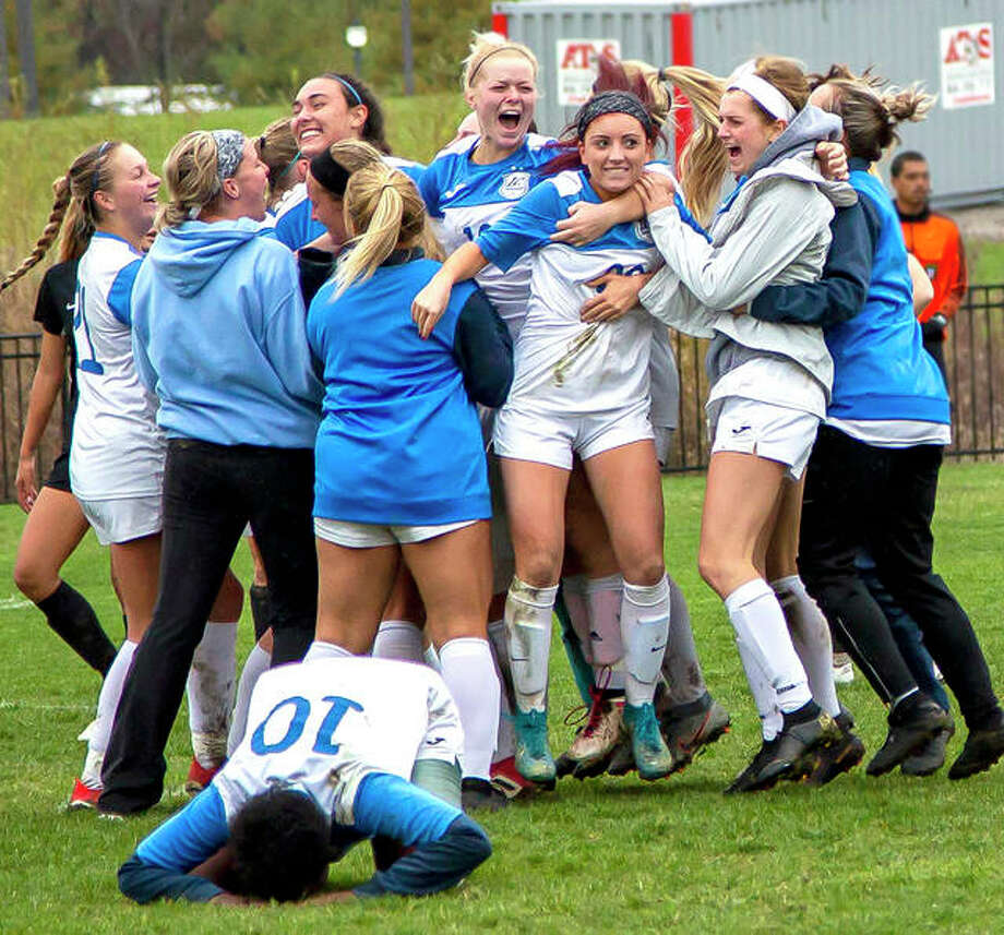 Lewis and Clark Community College players celebrate after defeating rival Southwestern Illinois College 1-0 in sudden-death overtime Monday in the championship game of the NJCAA Region 24 Tournament at LCCC's Tim Rooney Stadium. The Trailblazers' Callie Smith, third from left, scored the game-winning goal off an assist from Ella Kiely third from right. Photo: Jan Dona | For The Telegraph