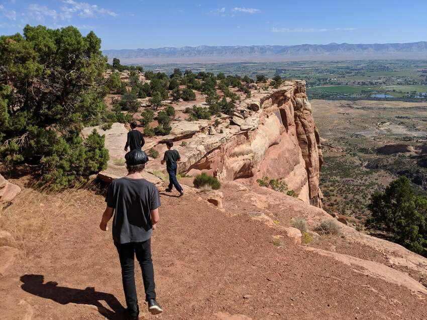 The kids explore the Canyon Rim trail at Colorado National Monument.