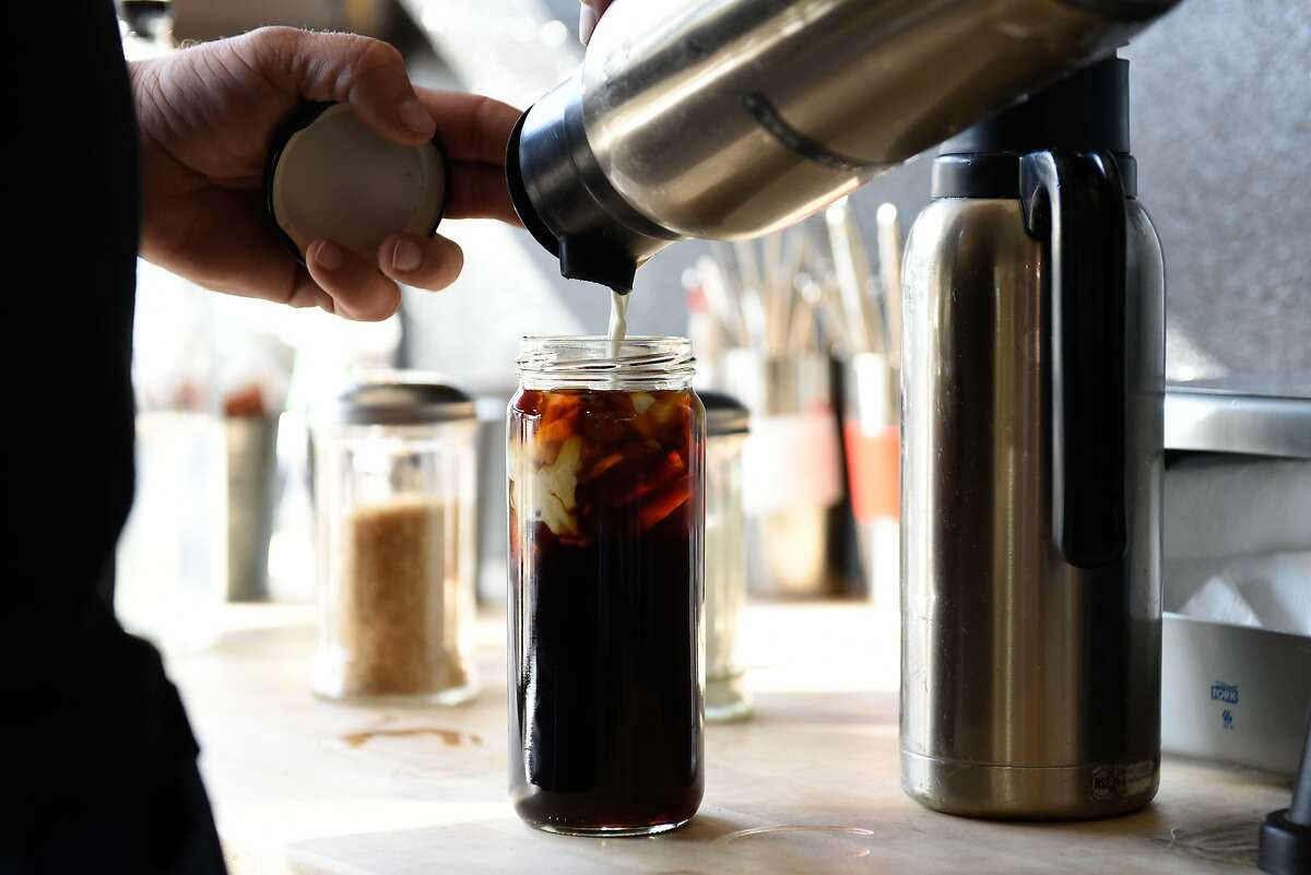 Perch Coffee House, the first cafe to work with nonprofit For Here Please, serves customers coffee to go in mason jars on October 30, 2019 in San Francisco, Calif.