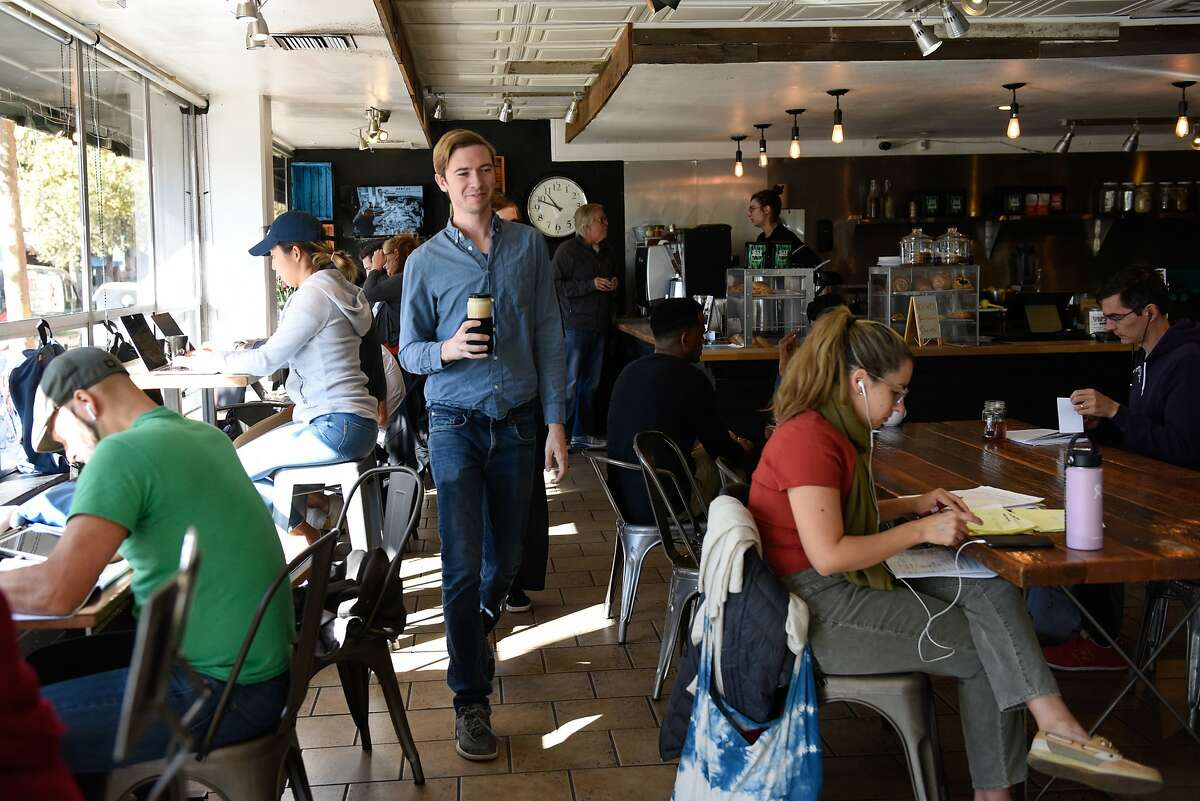 Perch Coffee House customer Nate Strong takes his coffee to go in a mason jar on October 30, 2019 in San Francisco, Calif.