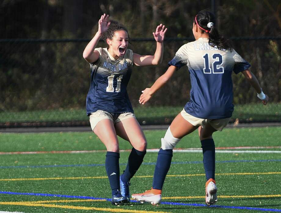 Notre Dame of Fairfield's Toni Domingos, left, celebrates her first half goal with teammate Tassia Ferriera in their SWC semi-finals girls soccer match with Weston in Fairfield, Conn. on Monday, November 4, 2019. Photo: Brian A. Pounds / Hearst Connecticut Media / Connecticut Post