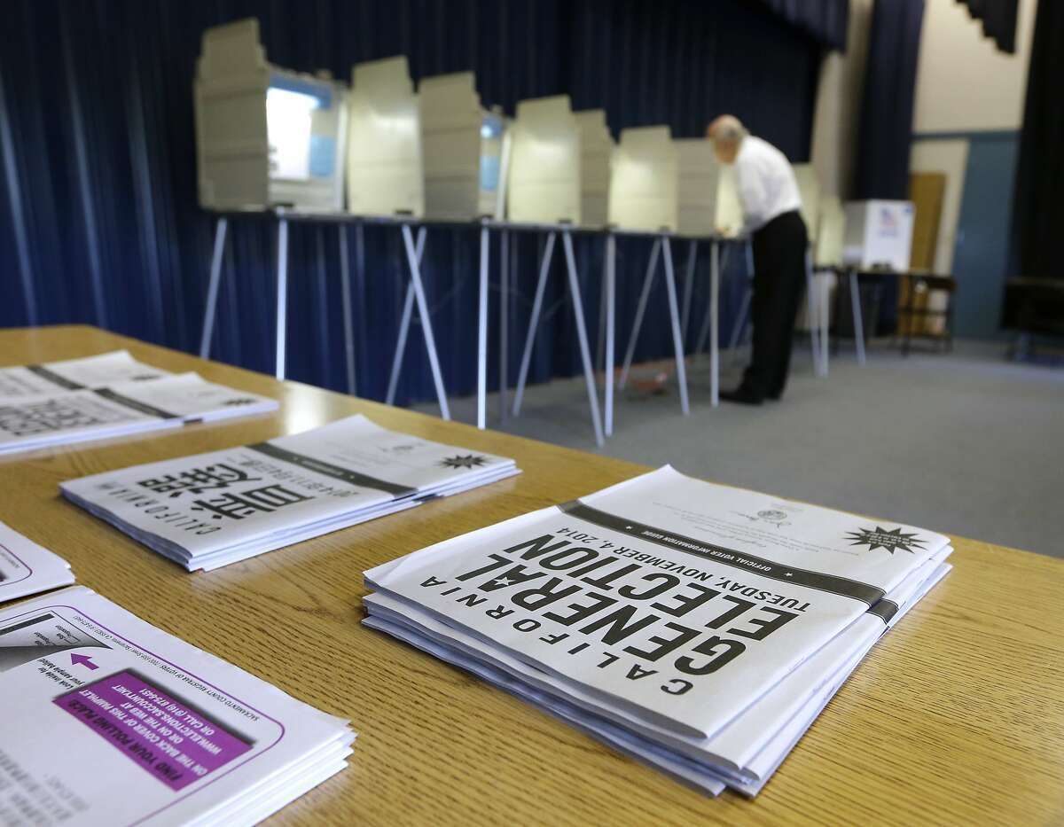 FILE - In this Nov. 4, 2014, file photo, a voter marks his ballot while voting in California. (AP Photo/Rich Pedroncelli, File)
