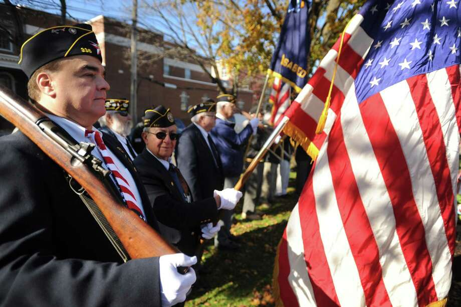 """Milford veterans including Gennaro Pellegrino, left, attend the annual Veterans Day ceremony at """"The Doughboy"""" World War 1 monument in Milford, Conn. on Sunday, November 11, 2018. Photo: Brian A. Pounds / Hearst Connecticut Media / Connecticut Post"""