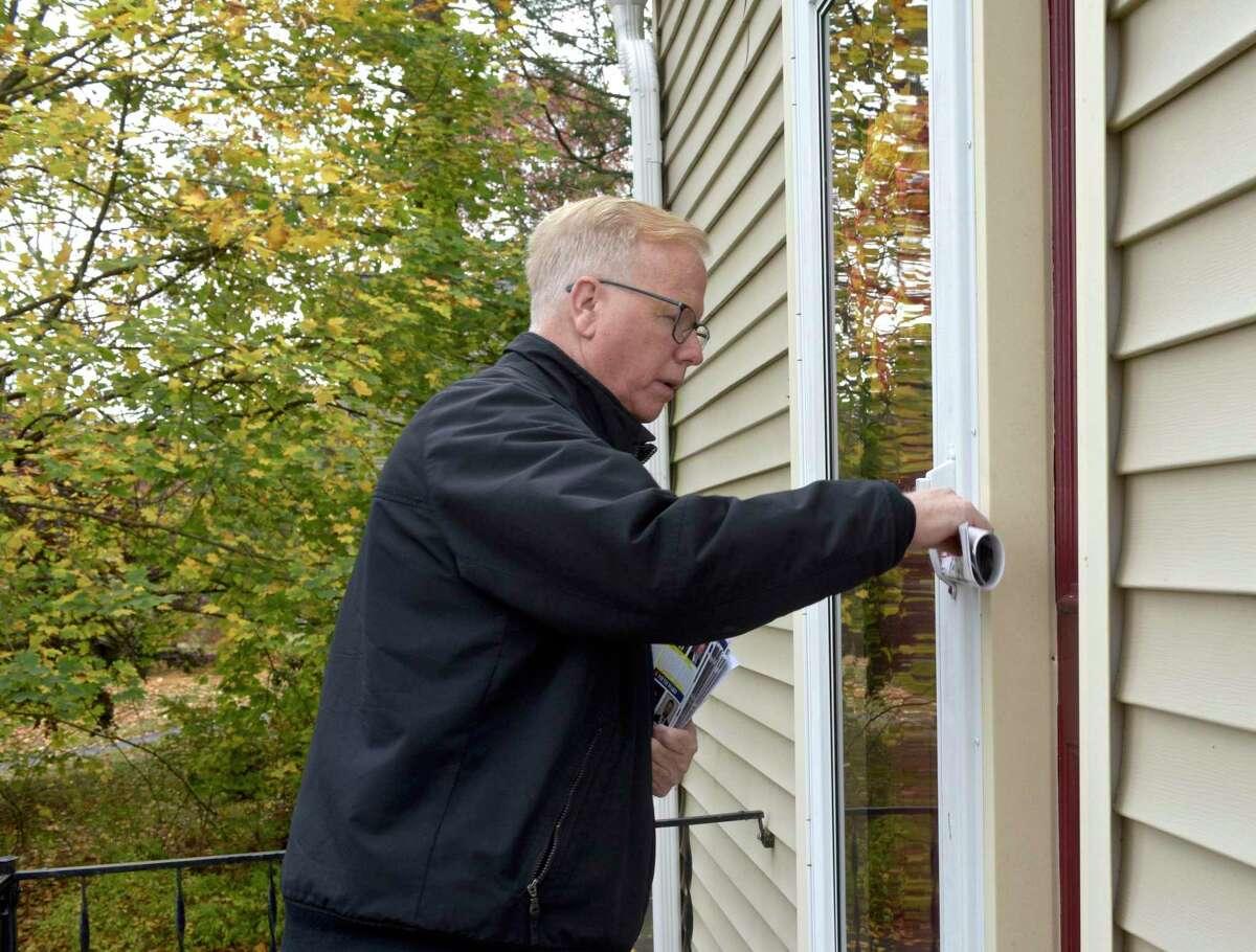 Republican incumbent Mayor Mark Boughton campaigns door to door on Morgan Avenue Monday afternoon, November 4, 2019, in Danbury, Conn.