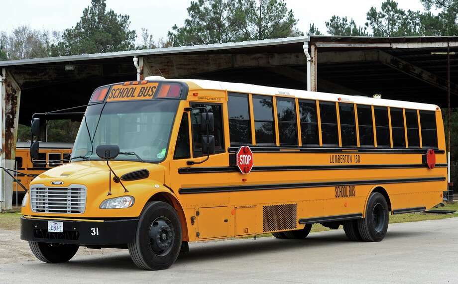 A Lumberton Independent School District bus sits outside the district's depot Wednesday afternoon.  Photo taken Wednesday 1/14/15 Jake Daniels/The Enterprise Photo: Jake Daniels / ©2014 The Beaumont Enterprise/Jake Daniels