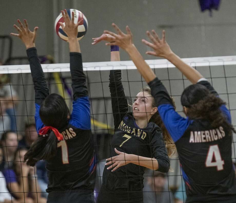 Midland High's Olivia Hale tries to tip the ball past the reach of El Paso Americas' Anna Arrieta and Kayla Villarreal 11/04/19 in the Class 6A bi-district playoff at MHS gym. Tim Fischer/Reporter-Telegram Photo: Tim Fischer/Midland Reporter-Telegram