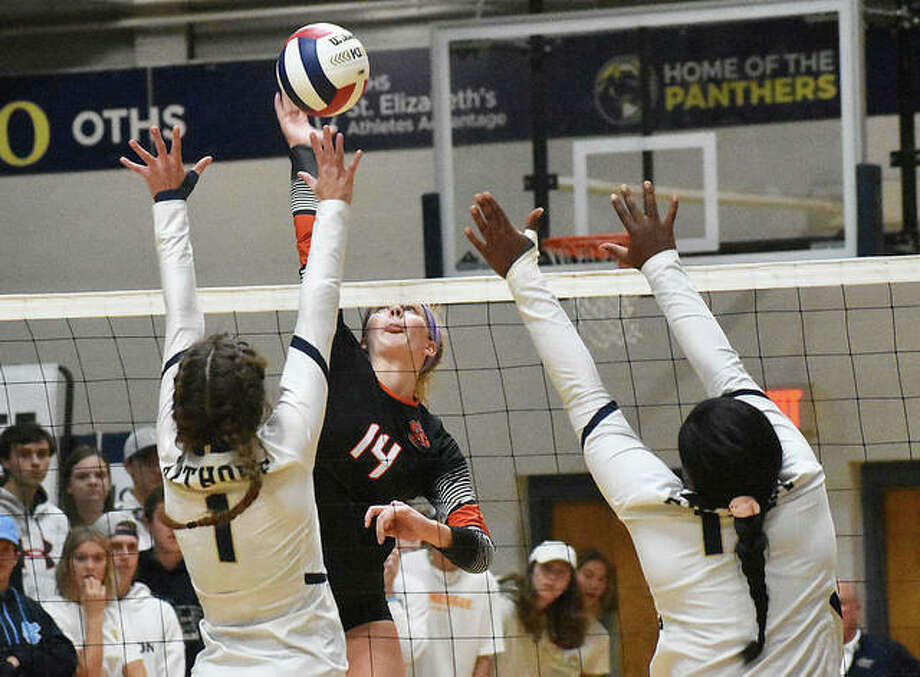 Edwardsville senior Maddie Isringhausen goes up for an attack in the first game against Althoff in the semifinals of the Class 4A O'Fallon Sectional. Photo: Matt Kamp|The Intelligencer