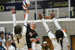 Edwardsville senior Maddie Isringhausen goes up for an attack in the first game against Althoff in the semifinals of the Class 4A O'Fallon Sectional.
