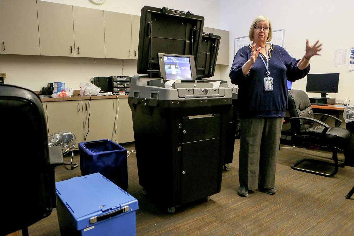 Bexar County Elections Administrator Jacque Callanen shows one of the new DS200 ballot scanner and vote tabulators in November. County officials said voting in the March 3 primary will be easier than ever, thanks to a larger number of early voting sites and a new voting system that allows voters to cast ballot at any of about 280 polling locations in the county on Election Day.