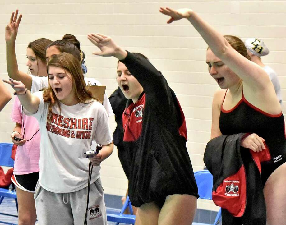 Cheshire swimmers cheer from the deck during the 2019 SCC championships on Monday. Photo: Peter Hvizdak / Hearst Connecticut Media / New Haven Register
