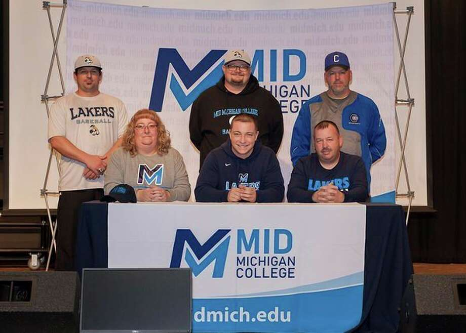 Coleman senior Tyler Germain (seated, center) signed with the Mid Michigan College baseball program on Monday. / FOREVER PHOTOGRAPHY
