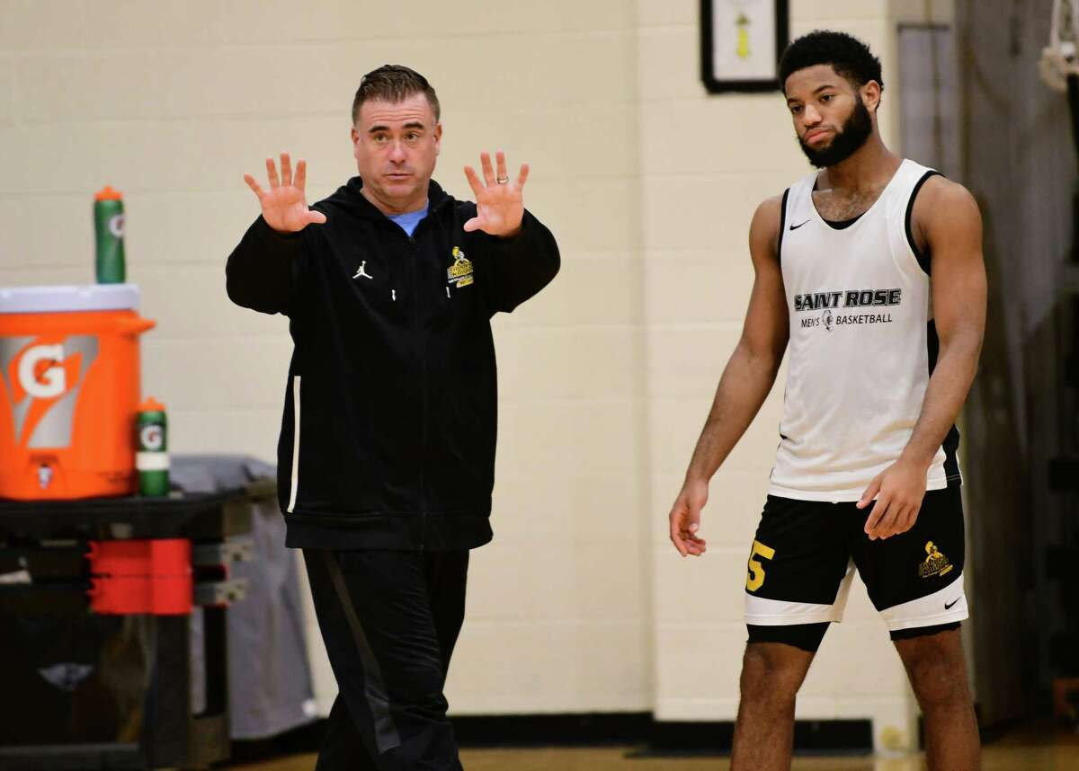 St. Rose men's basketball coach Mike Perno, left, talks to his players at practice on Monday, Nov. 4, 2019 in Albany, N.Y. (Lori Van Buren/Times Union)