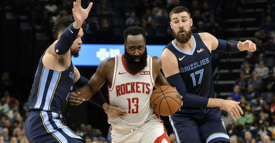 Houston Rockets guard James Harden (13) handles the ball between Memphis Grizzlies guard Dillon Brooks, left, and center Jonas Valanciunas (17) in the first half of an NBA basketball game Monday, Nov. 4, 2019, in Memphis, Tenn. (AP Photo/Brandon Dill) Photo: Brandon Dill/Associated Press
