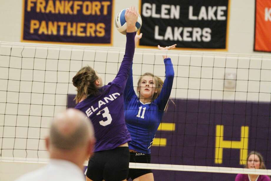 Onekama's Kaylin Sam attempts to block Leland's Olivia Lowe at the net Monday night during the Portagers' Division 4 district quarterfinal loss to the Comets. Photo: Kyle Kotecki/News Advocate