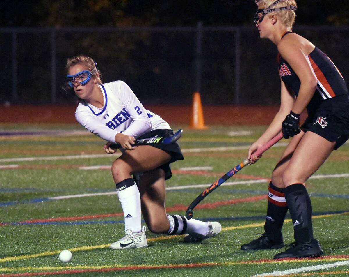 Darien's Molly Hellman (2) passes during Monday's FCIAC semifinal against New Canaan at Brien McMahon in Norwalk.