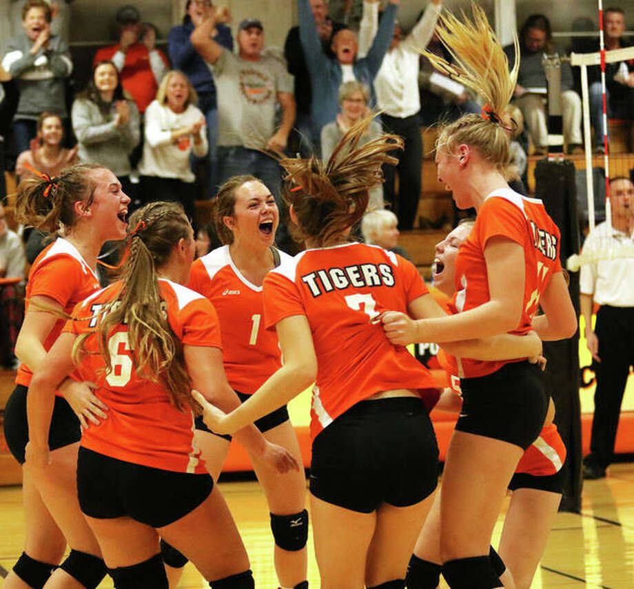 Greenfield's (from left) Baylee Bilbruck, Kaitlyn Foiles (6), Jessa Vetter (1), Kirstin Smay, Alexis Pohlman and Kersty Gibbs celebrate match point in their 25-23, 25-7 victory over New Athens in the semifinals of the Lincolnwood Class 1A Sectional in Raymond. Photo: Greg Shashack / The Telegraph