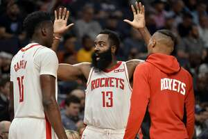 Houston Rockets guard James Harden (13) talks with center Clint Capela (15) and guard Russell Westbrook during a timeout in the second half of an NBA basketball game against the Memphis Grizzlies Monday, Nov. 4, 2019, in Memphis, Tenn. (AP Photo/Brandon Dill)