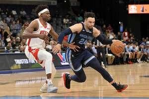 Memphis Grizzlies guard Dillon Brooks (24) drives ahead of Houston Rockets forward Danuel House Jr. in the second half of an NBA basketball game Monday, Nov. 4, 2019, in Memphis, Tenn. (AP Photo/Brandon Dill)