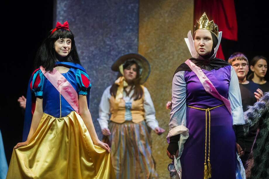 "Maddie Snawder in the role of Snow White, left, and Davis Veith in the role of Evil Queen, right, act out a scene during a dress rehearsal for Center Stage Theatre's production of ""Snow White Musicapalooza"" Monday, Nov. 4, 2019 at Midland Center for the Arts. (Katy Kildee/kkildee@mdn.net) Photo: (Katy Kildee/kkildee@mdn.net)"