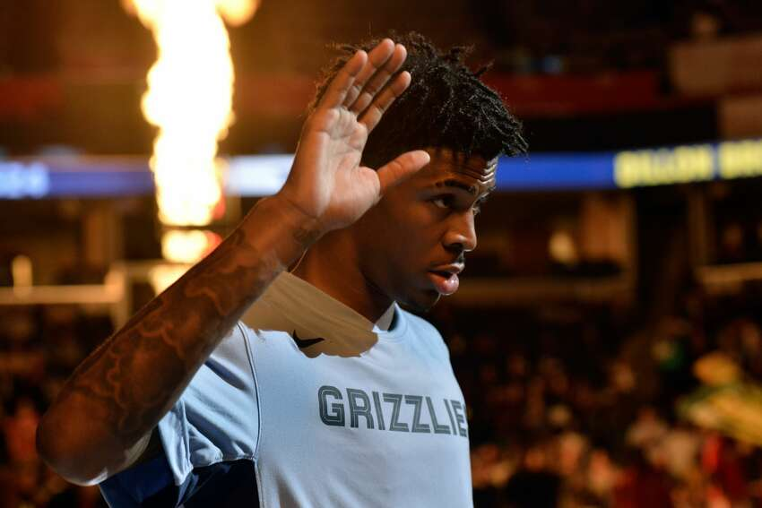 Memphis Grizzlies guard Ja Morant stands on the court during player introductions before an NBA basketball game against the Houston Rockets Monday, Nov. 4, 2019, in Memphis, Tenn. (AP Photo/Brandon Dill)