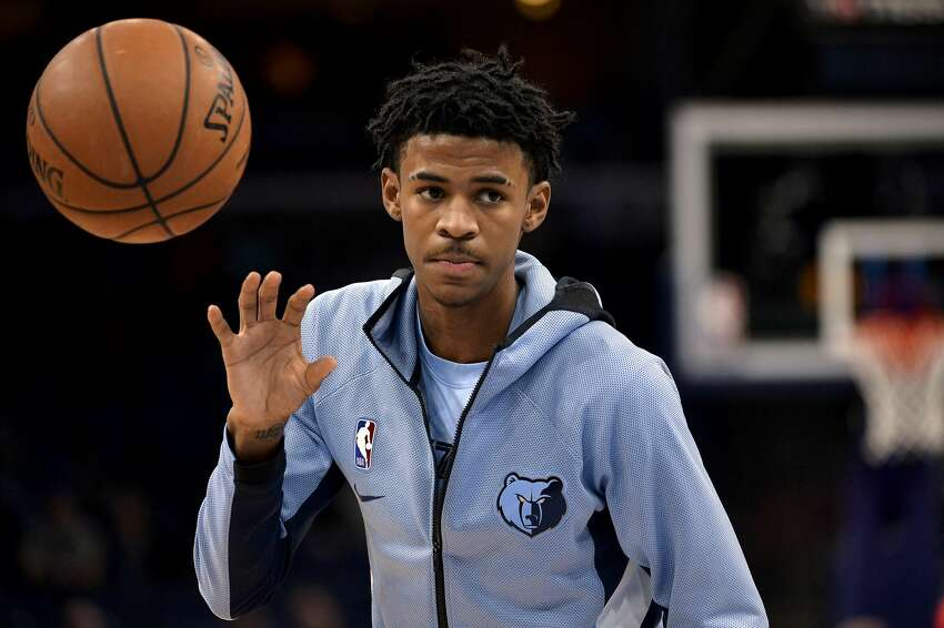 Memphis Grizzlies guard Ja Morant warms up before an NBA basketball game against the Houston Rockets Monday, Nov. 4, 2019, in Memphis, Tenn. (AP Photo/Brandon Dill)