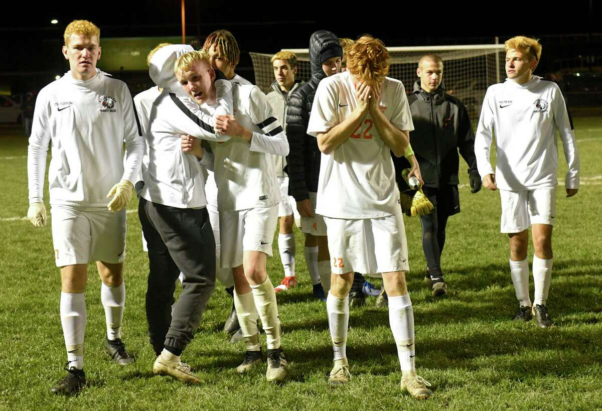 Bethlehem players get emotional after being defeated by Shenendehowa in the Class AA boys' soccer final on Monday, Nov. 4, 2019 in Colonie, N.Y. (Lori Van Buren/Times Union)