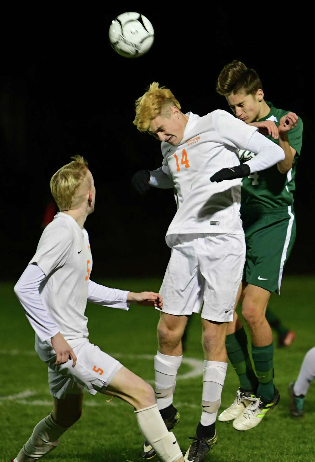 Bethlehem's Keith Winne, center, vies for the ball with Shenendehowa's Will Burdick in the Class AA boys' soccer final on Monday, Nov. 4, 2019 in Colonie, N.Y. (Lori Van Buren/Times Union)