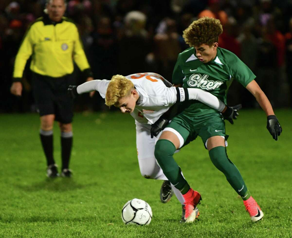 Bethlehem's Lleyton Emery, left, vies for the ball with Shenendehowa's Darien Espinal in the Class AA boys' soccer final on Monday, Nov. 4, 2019 in Colonie, N.Y. (Lori Van Buren/Times Union)