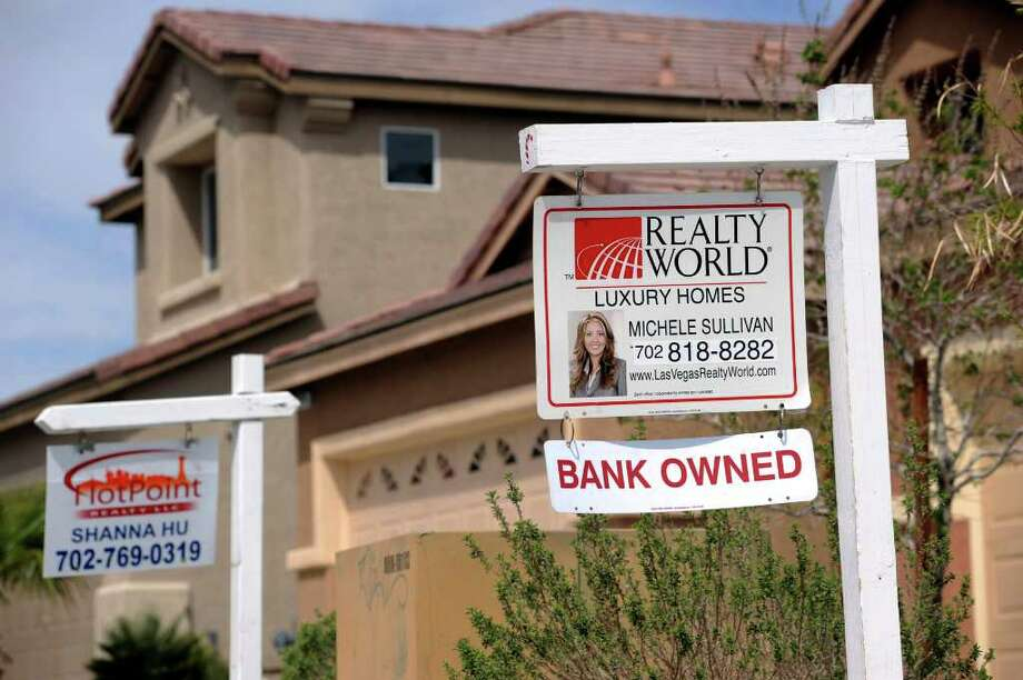 """A """"bank owned"""" sign sits outside a foreclosed home in the Mountain's Edge neighborhood of Las Vegas, Nevada, U.S., on Thursday, April 15, 2010. Foreclosure filings in the U.S. rose 16 percent in the first quarter from a year earlier and bank seizures hit a record as lenders stepped up action against delinquent homeowners, according to RealtyTrac Inc. Photographer: Jacob Kepler/Bloomberg Photo: Jacob Kepler, Bloomberg"""