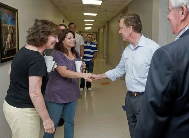 Ned Lamont meets CARTUS employees in a hall at Danbury's second-largest employer. Lamont toured CARTUS on 40 Apple Ridge Road. Monday, Aug. 9, 2010 Photo: Scott Mullin / The News-Times Freelance